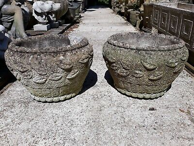 pair of small round decorative stone/concrete garden pots/planters - chip to rim