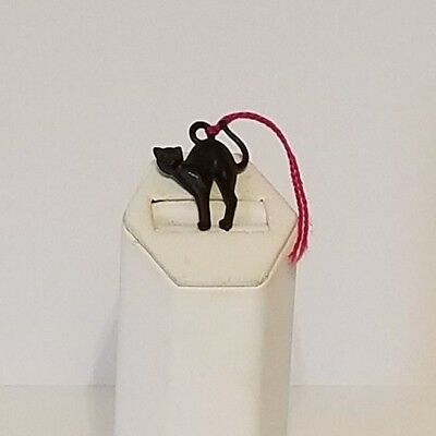 The black cat from Zell Vintage Plastic Black Cat Wine Bottle Charm German Cat