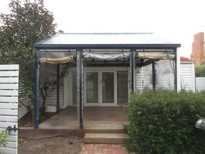 DECKING/PERGOLA - MERBAU, STAINED , TIMBER PITCHED LASER LITE ROOFING , 4o