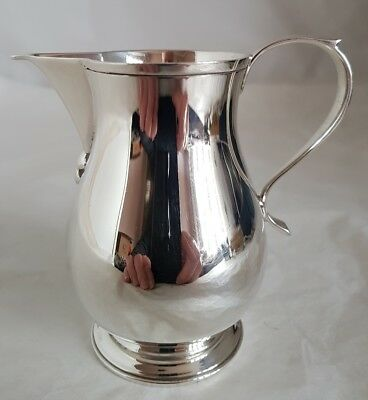An Edwardian sterling silver cream jug .Birmingham 1960.By J B Chatterley & Sons