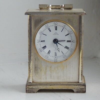 A vintage small Swiss 8 day 15 jewel mantel/carriage clock- good working order.