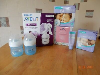 Avent manual breast pump, bottles and lansinoh breastfeeding accesories