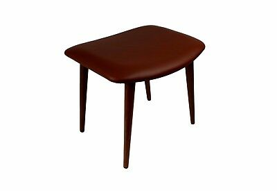 A Danish mid century teak ottoman upholstered with brown aniline leather