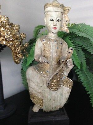 Hand Painted, Timber Statue of Thai artist playing what we think is a Sueng