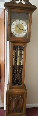 A oak longcase grandfather clock