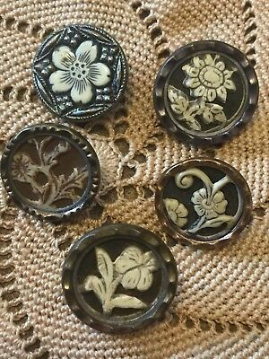 Five Small Ivoroid Flower Buttons.