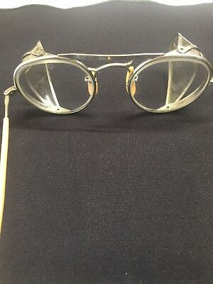 Very nice clean pair of Bausch & Lomb safety glasses . Very clean . W/Box.