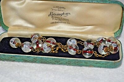 vintage art deco style red lined flowered pools of light glass bead necklace