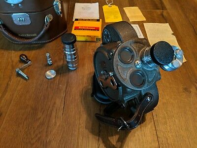 Bell & Howell Filmo 70-DL 16MM Movie Camera with case and manuals