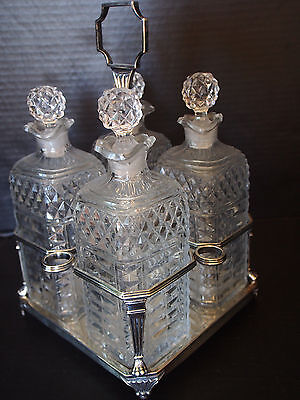 Antique English Sterling Paw Claw Caddy Tantalus 4 French Cut Crystal Decanters