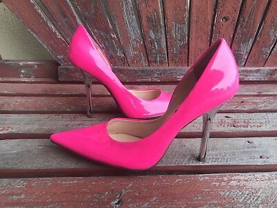 GUESS neon pink pumps.