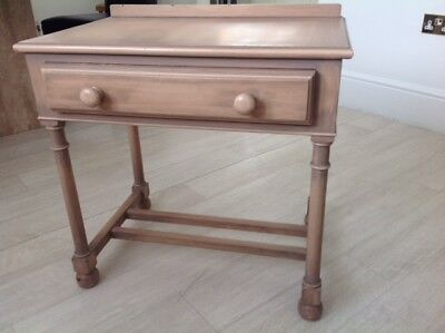 A matching pair of good quality hardwood bedside tables