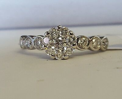 14ct gold  diamond floral cluster ring