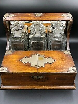 Antique 19th c English tiger Oak wood Tantalus w three decanters