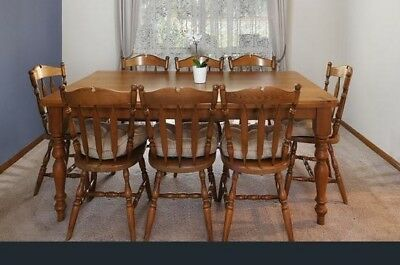 Solid timber 8 seater dining table and 8 chairs