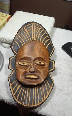Unusual vintage hand carved African wall sculpture,mask bout 9.5 x 5.2