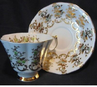 Queen Anne #167 White Tea Cup & Saucer Gold/Green Daisy Shape Pattern