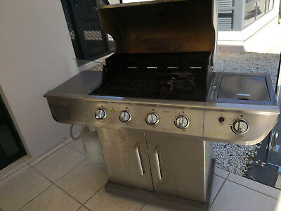gas barbecue with cover and two bottles