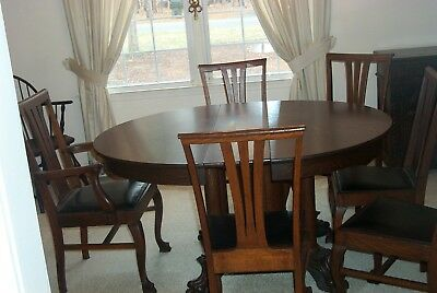 LARGE EX 1880 Tiger oak dinning room set round table & (5) chairs-(4) leaves