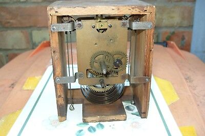Clock Movement  Unknown Swinging  Pendulum  Backwards