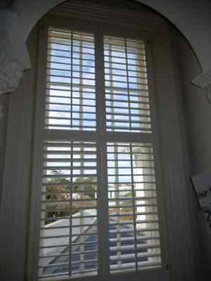SHUTTERS – CENTRE OPENING TIMBER PLANTATION SHUTTERS, 945w x 2100h, removed 7h