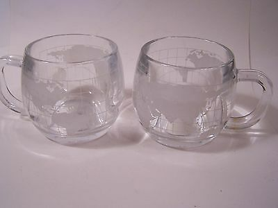 2 Glass Mugs The Nestle Co. WORLD ETCHED Colonial Cupboard 10 oz.