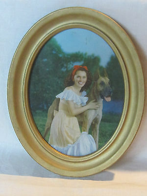 Vintage hand tinted photo, lovely girl and her great dane dog