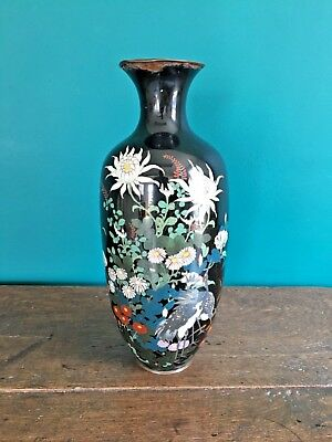 beautiful antique cloisonne black vase with a brass rim and floral decoration