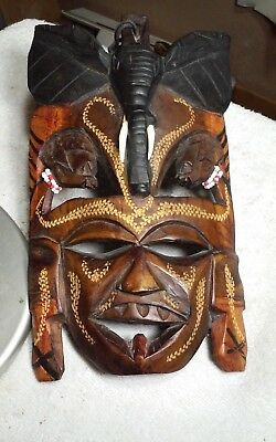 Incredible hand carved wooden African mask with bead accents,wall sculpture