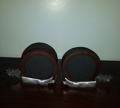 Two Marlboro Pewter Cowboy Spur Coaster Holders & 8 Leather Coasters.