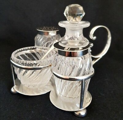 An Edwardian sterling silver breakfast cruet set. London 1907.By Asher Solovitch