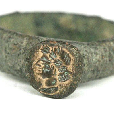 A Roman bronze ring the bezel engraved with a female bust y134