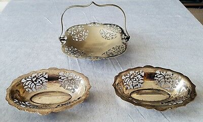 3 small silver plated dishes.