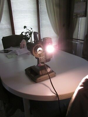 Vintage Movie Projector, Revere Camera Co with working bulb.