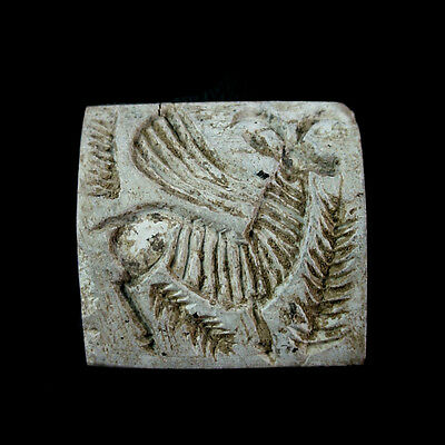A steatite bead seal with a winged bull.x9475