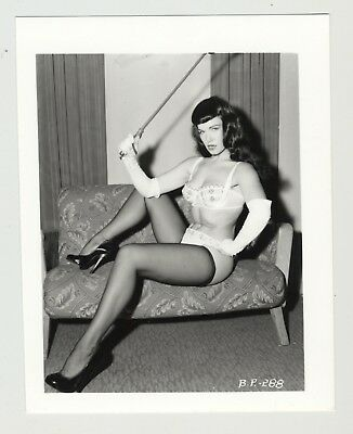 Bettie Page On Couch W. Whip / Stockings - Gloves (Vintage Photo: Irving Klaw)