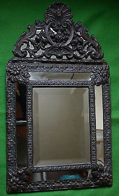 From France, An Antique Repousse Copper Mirror.