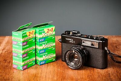 Yashica Mg-1 35Mm Rangefinder Camera W/ 6 Rolls Of Film And A New Battery!