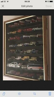 Model/toy Car Collection In Display Cabinet
