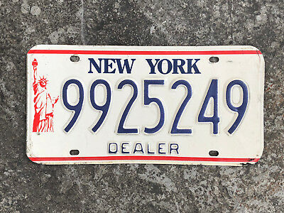 2000's New York DEALER License Plate #9925249 with the Statue of Liberty