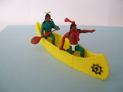 timpo canoe yellow colourand green clothing on Indians all in good condition