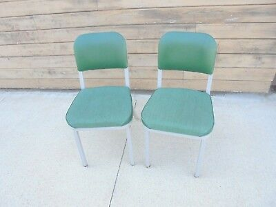 2 vintage industrial chairs united chair metal frame padded seats green office