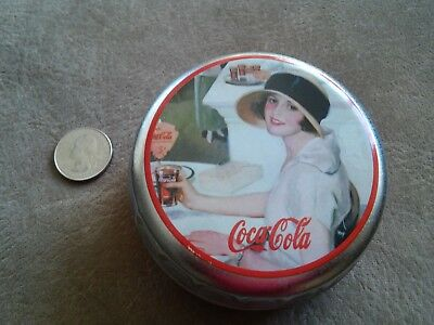Coca Cola Tin - 1999  Lady in Hat drinking a coke