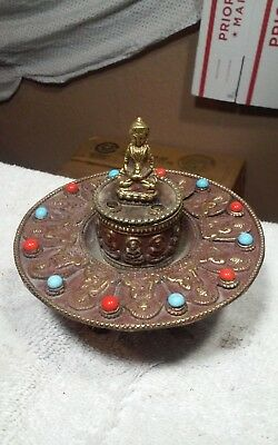 Vintage metal Asian incense burner with buddhas and stones