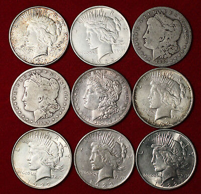 Lot of 9 Morgan and Peace silver Dollars mixed dates