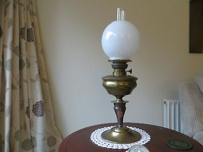 beautiful oil lamp with white globe and chimney