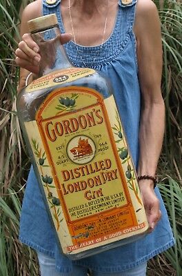 Antique glass Gordons Dry Gin advertising liquor bottle bank