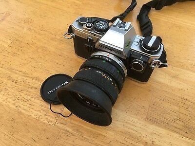 Olympus OM10 35mm SLR Film Camera with 3 lenses, manual adapter and case.