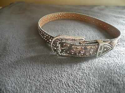 Size 28 camouflage western belt with faux rhinestones /pink stones on it