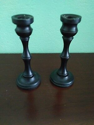 A pair of small  candlesticks, 7inches high. Stamped 'ebony'.
